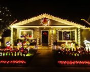 Christmas lights in front of a house