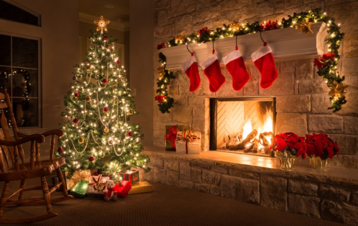 Christmas. Glowing fireplace, hearth, tree. Red stockings. Gifts and decorations.